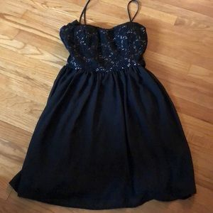 Black dress with removable straps nd top detailing